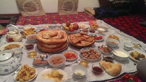 A Kyrgyz spread; notice the walnuts, apples and peach compote.